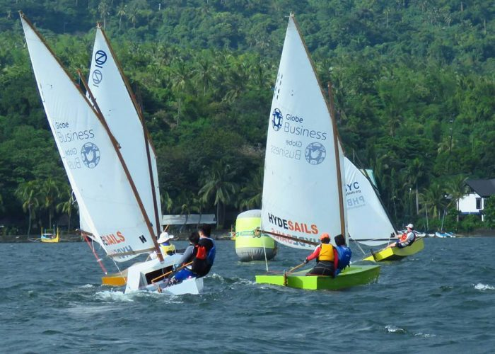 Close sailboat racing for peanuts in Developing Nations