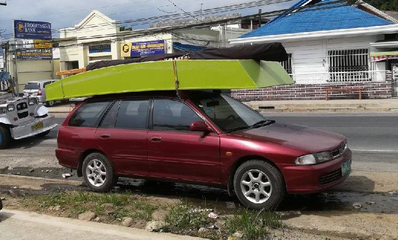 Oz Goose sailboat can be roofracked. No trailer necessary - opengoose.com